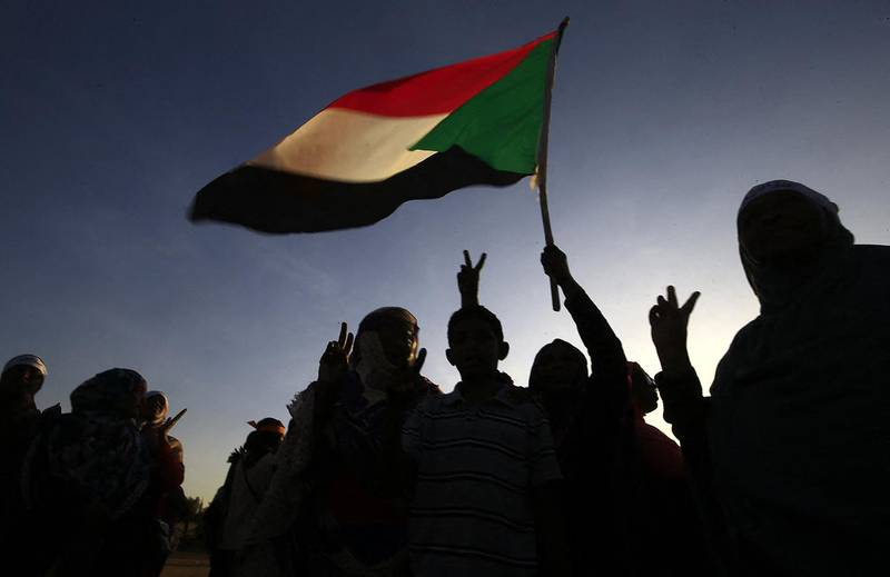 """Sudanese women march in Khartoum to mark International Day for Eliminating Violence against Women, in the first such rally held in the northeast African country in decades, on November 25, 2019. - Chanting """"Freedom, peace, justice,"""" the catchcry of the protest movement that led to autocrat Omar al-Bashir's ouster in April, the demonstrators took to the streets in the Burri district, a site of regular anti-Bashir protests earlier this year. (Photo by Ashraf SHAZLY / AFP)"""