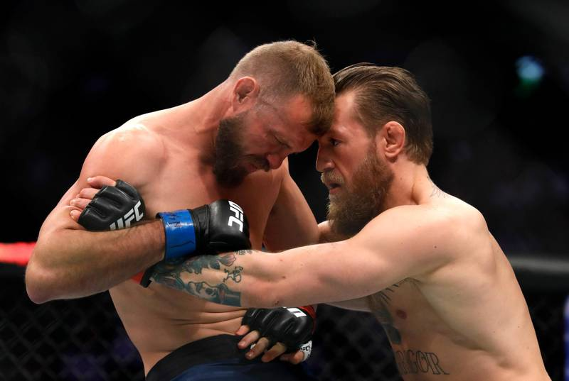 LAS VEGAS, NEVADA - JANUARY 18: Conor McGregor (R) fights Donald Cerrone in a welterweight bout during UFC246 at T-Mobile Arena on January 18, 2020 in Las Vegas, Nevada. McGregor won by first-round TKO.   Steve Marcus/Getty Images/AFP