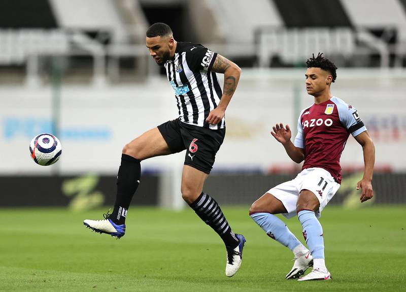 NEWCASTLE UPON TYNE, ENGLAND - MARCH 12: Jamaal Lascelles of Newcastle United battles for possession with Ollie Watkins of Aston Villa during the Premier League match between Newcastle United and Aston Villa at St. James Park on March 12, 2021 in Newcastle upon Tyne, England. Sporting stadiums around the UK remain under strict restrictions due to the Coronavirus Pandemic as Government social distancing laws prohibit fans inside venues resulting in games being played behind closed doors. (Photo by Clive Brunskill/Getty Images)