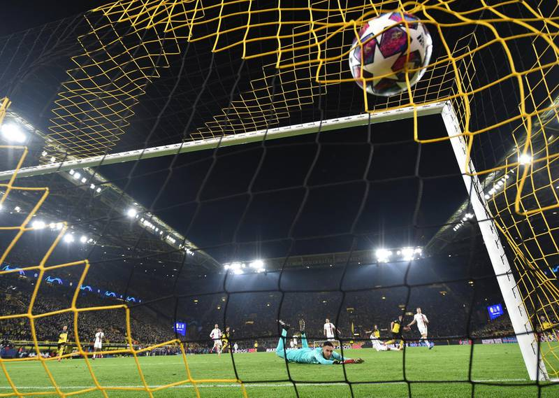 DORTMUND, GERMANY - FEBRUARY 18: Erling Braut Haaland of Dortmund scores his second goal during the UEFA Champions League round of 16 first leg match between Borussia Dortmund and Paris Saint-Germain at Signal Iduna Park on February 18, 2020 in Dortmund, Germany. (Photo by Stuart Franklin/Bongarts/Getty Images)