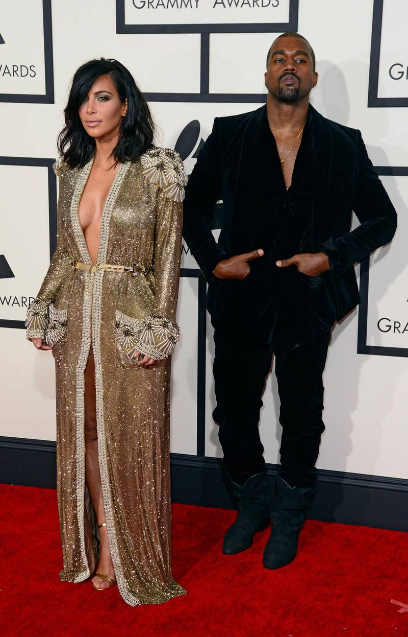 epa04611006 Kim Kardashian and Kanye West (R) arrive for the 57th annual Grammy Awards held at the Staples Center in Los Angeles, California, USA, 08 February 2015.  EPA/MICHAEL NELSON