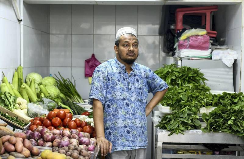 Abu Dhabi, United Arab Emirates - Mohammed Furqan, 47 originally works at a Fruit and vegetable shop in Tourist Club Area. Khushnum Bhandari for The National