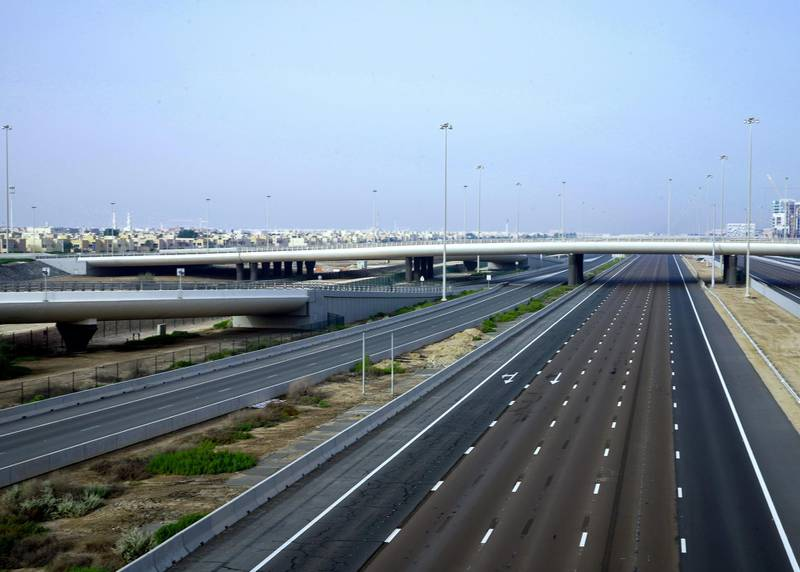 Abu Dhabi, United Arab Emirates, March 27, 2020.  The nearly empty Dubai-Abu Dhabi road on the first day of the UAE cleaning campaign.  Emiratis and residents across the UAE must stay home this weekend while a nationwide cleaning and sterilisation drive is carried out. Victor Besa / The National