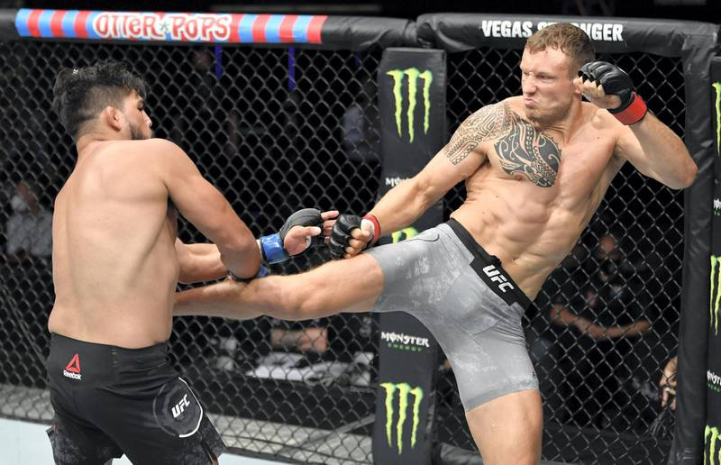ABU DHABI, UNITED ARAB EMIRATES - JULY 19: (R-L) Jack Hermansson of Sweden kicks Kelvin Gastelum in their middleweight bout during the UFC Fight Night event inside Flash Forum on UFC Fight Island on July 19, 2020 in Yas Island, Abu Dhabi, United Arab Emirates. (Photo by Jeff Bottari/Zuffa LLC via Getty Images)