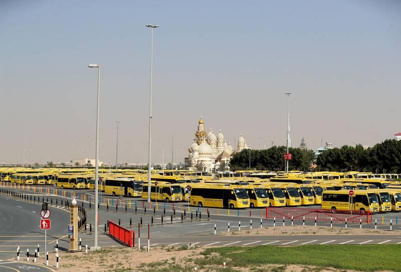 Dubai, United Arab Emirates - Reporter: N/A: A lot of school busses sit outside Global Village. Wednesday, April 1st, 2020. Dubai. Chris Whiteoak / The National
