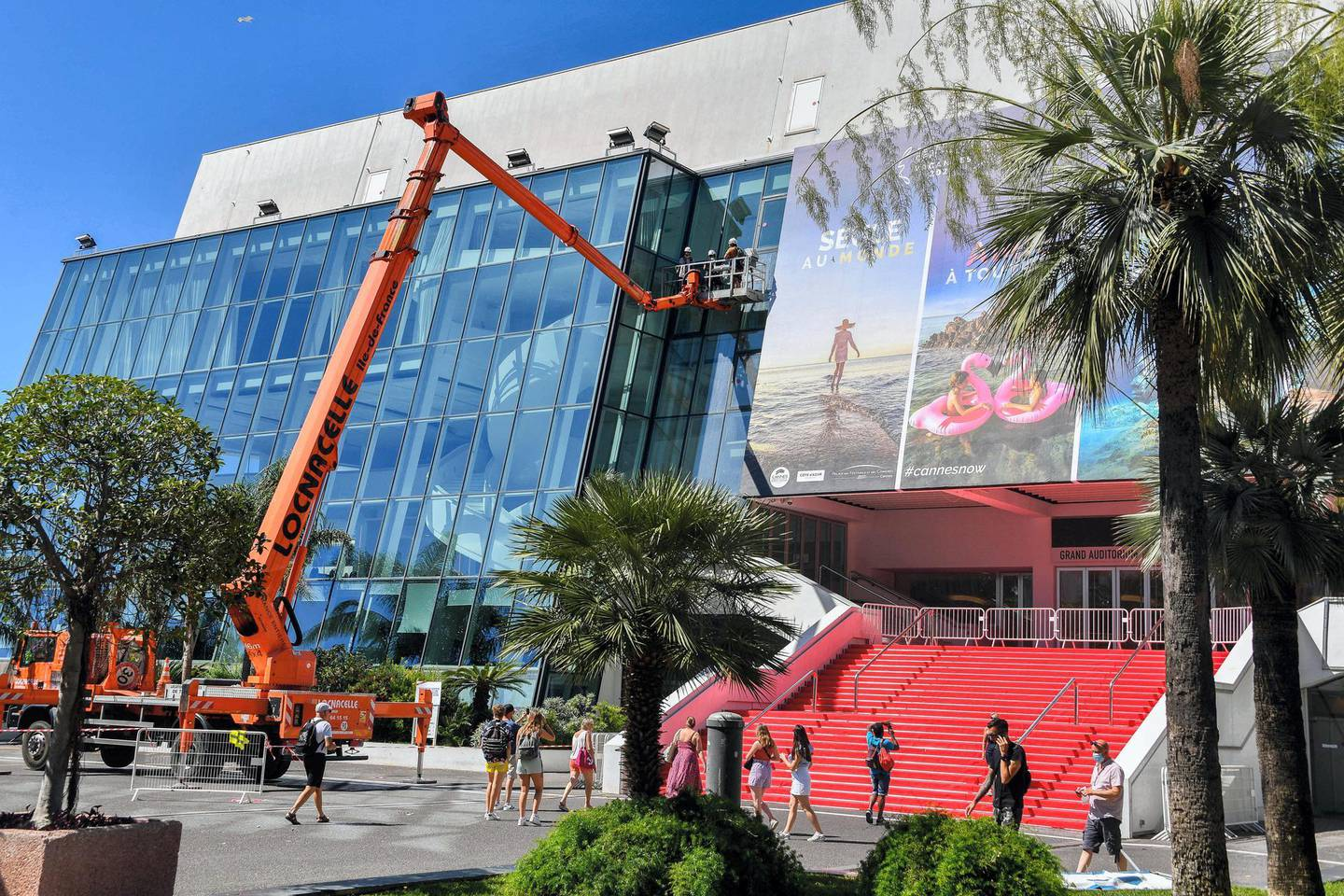 Workers wash the windows during the preparations for the Cannes festival at the Palais des Festivals in Cannes, France, on June 25, 2021. Photo by Lionel Urman/ABACAPRESS.COM