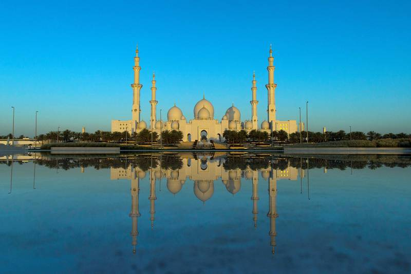 Abu Dhabi, United Arab Emirates, May 27, 2017:    Sheikh Zayed Grand Mosque is seen during sun rise on the first day of the holy month of Ramadan from Wahat Al Karama, the martyrs' memorial, in Abu Dhabi on May 27, 2017.  Muslims around the globe observe the holy fasting month of Ramadan where they refrain from drinking, eating, smoking and sex from dawn to dusk. Christopher Pike / The National  Job ID: 84573 Reporter:  N/A Section: News Keywords: *** Local Caption ***  CP0527-na-morning prayers-AD-06.JPG