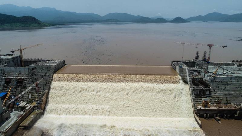 """This handout picture taken on July 20, 2020, and released by Adwa Pictures on July 27, 2020, shows an aerial view Grand Ethiopian Renaissance Dam on the Blue Nile River in Guba, northwest Ethiopia. Ethiopia said on July 21 it had hit its first-year target for filling the Grand Ethiopian Renaissance Dam, a concrete colossus 145 metres (475 feet) high that has stoked tensions with downstream neighbours Egypt and Sudan.  - RESTRICTED TO EDITORIAL USE - MANDATORY CREDIT """"AFP PHOTO / ADWA PICTURES / YIRGA MENGISTU"""" - NO MARKETING NO ADVERTISING CAMPAIGNS - DISTRIBUTED AS A SERVICE TO CLIENTS    / AFP / Adwa Pictures / Adwa Pictures / Yirga MENGISTU / RESTRICTED TO EDITORIAL USE - MANDATORY CREDIT """"AFP PHOTO / ADWA PICTURES / YIRGA MENGISTU"""" - NO MARKETING NO ADVERTISING CAMPAIGNS - DISTRIBUTED AS A SERVICE TO CLIENTS"""