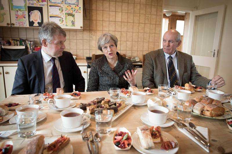Britain's Prime Minister Theresa May has lunch with farmers at Fairview Farm in Bangor, Northern Ireland, March 29, 2018.   Stefan Rousseau/Pool via Reuters
