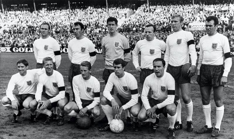 The English national soccer team players pose for a group picture after their victory over Denmark in the pre World Cup friendly in Idraetsparken in 1966. English won the match 2-0 with goal scored by John (Jackie) Charlton and George Eastham. Standing, left-to-right: Ray Wilson, Jimmy Greaves, Paul Bonetti, Nobby Stiles, Bobby Moore (captain), John Connelly; Front row: Alan Ball, Jacky Charlton, George Eastham, Geoff Hurst, George Cohen. Absents on the picture: Gordon Banks, Bobby Charlton, Martin Peters and Roger Hunt. (Photo by STF / AFP)