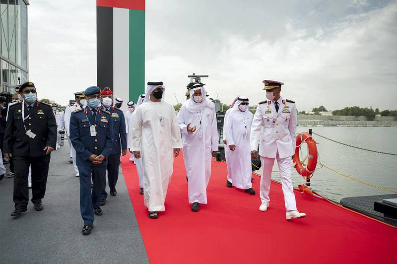 ABU DHABI, UNITED ARAB EMIRATES - February 21, 2021: HH Sheikh Hamed bin Zayed Al Nahyan, Member of Abu Dhabi Executive Council (3rd L) tours the International Defence Exhibition and Conference 2021 (IDEX), at ADNEC. Seen with HE Major General Essa Saif Al Mazrouei, Deputy Chief of Staff of the UAE Armed Forces (2nd R) and Rear Admiral Pilot HH Sheikh Saeed bin Hamdan bin Mohamed Al Nahyan, Commander of the UAE Naval Forces (R).  ( Rashed Al Mansoori / Ministry of Presidential Affairs ) ---