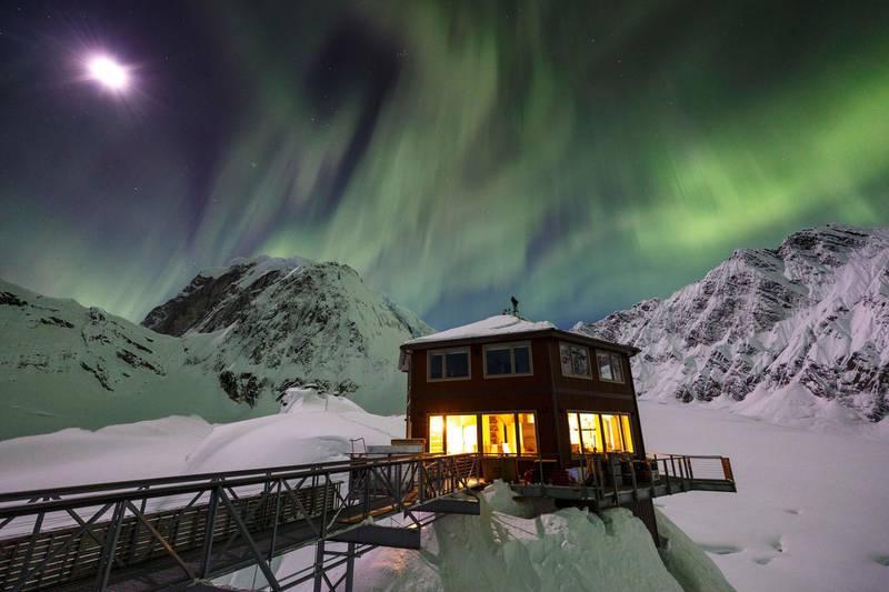 Aurora Borealis (Northern Lights) and Sheldon Chalet in the Alaska Range in the Don Sheldon Amphitheater. Photo by Jeff Schultz