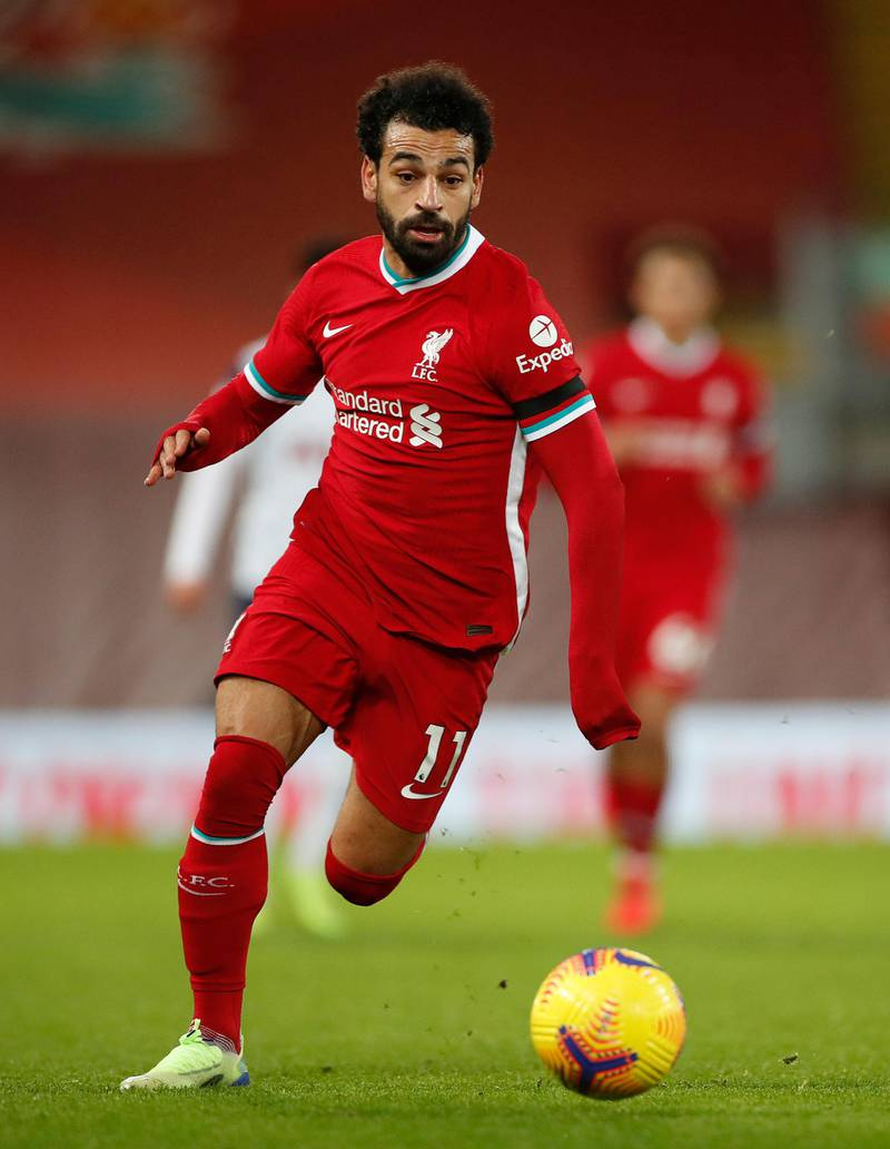 LIVERPOOL, ENGLAND - DECEMBER 16: Mohamed Salah of Liverpool in action during the Premier League match between Liverpool and Tottenham Hotspur at Anfield on December 16, 2020 in Liverpool, England. A limited number of fans (2000) are welcomed back to stadiums to watch elite football across England. This was following easing of restrictions on spectators in tiers one and two areas only. (Photo by Clive Brunskill/Getty Images)