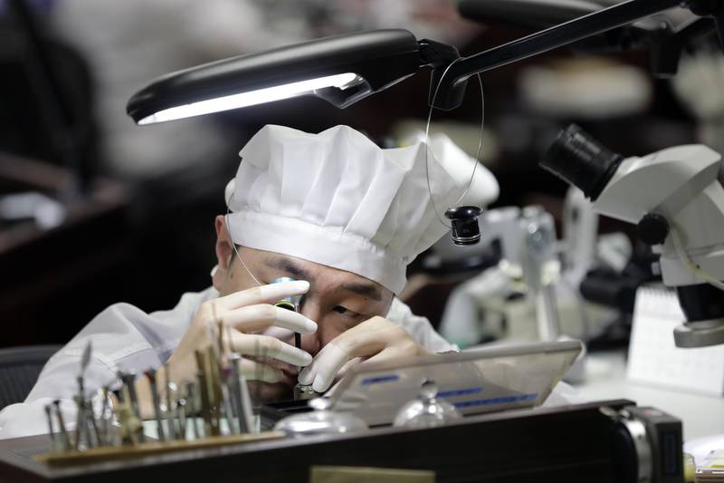 A watchmaker uses an eyepiece to assemble a mechanical movement of a Grand Seiko brand watch manufactured by Seiko Watch Corp. at the Morioka Seiko Instruments Inc. factory in Shizukuishi Town, Iwate Prefecture, Japan, on Wednesday, Jan. 24, 2018. Grand Seiko watches are known for their accuracy and have simpler dials and a more classic style than regular Seikos. Forty years after nearly wiping out the Swiss watch industry with cheap quartz models, Japanese brands likeSeikoandCitizenare eyeing the high end of timekeeping that's been the Alpine country's turf.Photographer: Kiyoshi Ota/Bloomberg