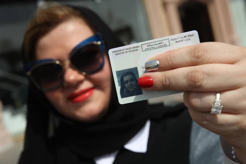 JEDDAH, SAUDI ARABIA - JUNE 24:  Nada Edlibi holds up her Saudi Arabian driver's license on the first day that she is legally allowed to drive in Saudi Arabia on June 24, 2018 in Jeddah, Saudi Arabia. Saudi Arabia has today lifted its ban on women driving, which had been in place since 1957. The Saudi government, under Crown Prince Mohammad Bin Salman, is phasing in an ongoing series of reforms to both diversify the Saudi economy and to liberalize its society. The reforms also seek to empower women by restoring them basic legal rights, allowing them increasing independence and encouraging their participation in the workforce. Saudi Arabia is among the most conservative countries in the world and women have traditionally had much fewer rights than men.  (Photo by Sean Gallup/Getty Images)