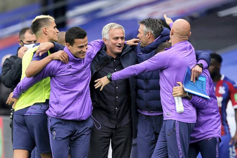 Tottenham Hotspur's Portuguese head coach Jose Mourinho (C) celebrates with his coaching staff after the English Premier League football match between Crystal Palace and Tottenham Hotspur at Selhurst Park in south London on July 26, 2020. (Photo by Will Oliver / POOL / AFP) / RESTRICTED TO EDITORIAL USE. No use with unauthorized audio, video, data, fixture lists, club/league logos or 'live' services. Online in-match use limited to 120 images. An additional 40 images may be used in extra time. No video emulation. Social media in-match use limited to 120 images. An additional 40 images may be used in extra time. No use in betting publications, games or single club/league/player publications. /