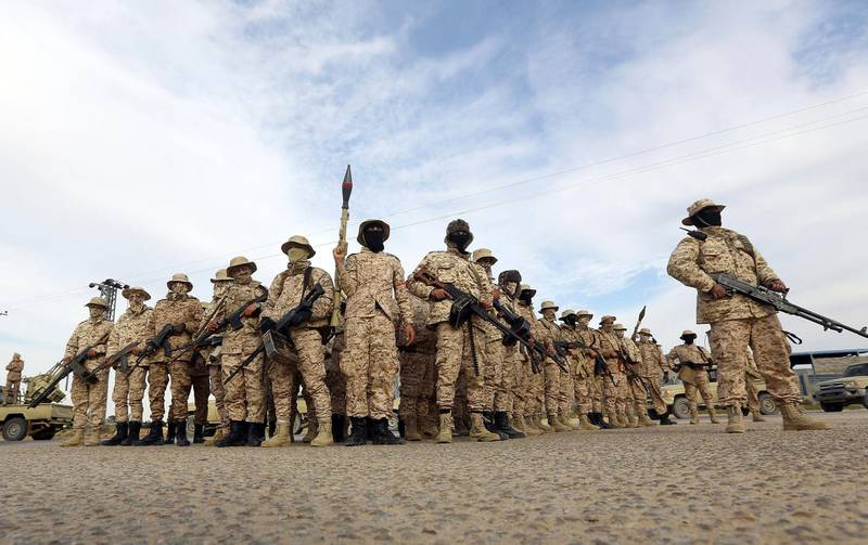 Members of the Tripoli Protection Force, an alliance of militias from the capital city, patrol an area south of the Libyan capital on January 18, 2019, during clashes with the Seventh Brigade group from the town of Tarhuna. - Two days of clashes between rival militias near Libya's capital Tripoli have left 10 people dead and 41 wounded, the health ministry said on January 17. Fighting between armed groups erupted Wednesday despite a truce deal four months ago that had halted deadly battles in the city. (Photo by Mahmud TURKIA / AFP)