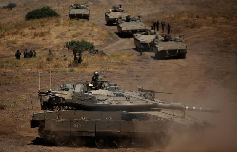 A picture shows an Israel military drill near Kibbutz Merom Golan in the Israeli-annexed Golan Heights on June 9, 2021. / AFP / JALAA MAREY