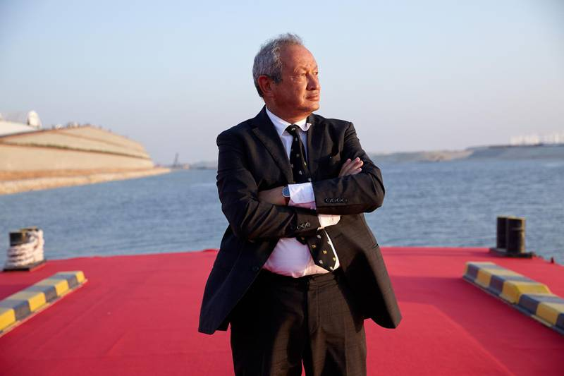 Egyptian billionaire Naguib Sawiris poses for a photograph on a floating pontoon in front of the New Suez Canal, operated by the Suez Canal Authority, in Ismailia, Egypt, on Thursday, Aug. 6, 2015. The expansion will meet future demand, with traffic expected to double to 97 vessels a day by 2023, said Mohab Mameesh, head of the Suez Canal Authority. Photographer: Shawn Baldwin/Bloomberg *** Local Caption *** Naguib Sawiris