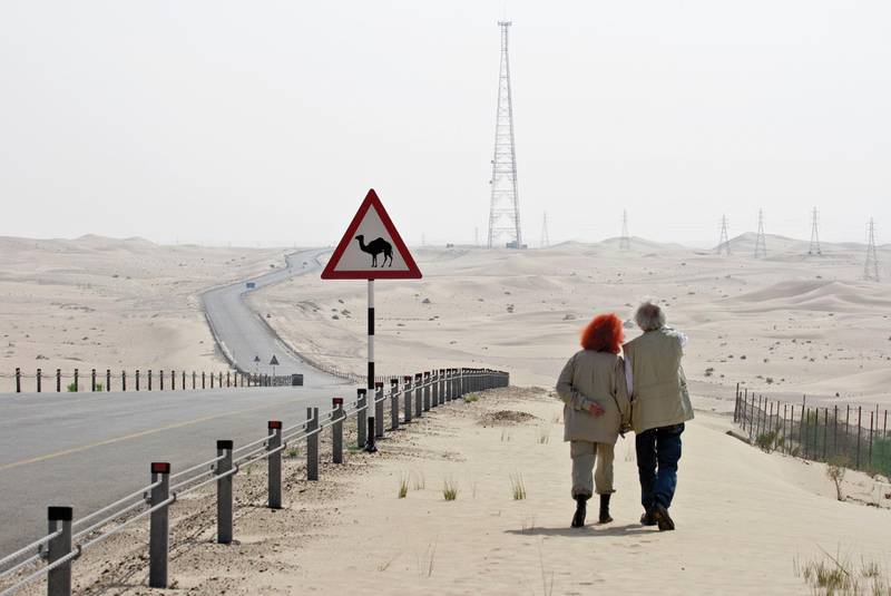 """Christo and Jeanne-Claude scouting locations for the site of The Mastaba October 2007 Photo: Wolfgang Volz © 2007 Christo Print Size: 5 1/4 x 7 7/8"""" (13.3 x 20 cm) *** Local Caption ***  na15mr-focus-christo2.jpg"""