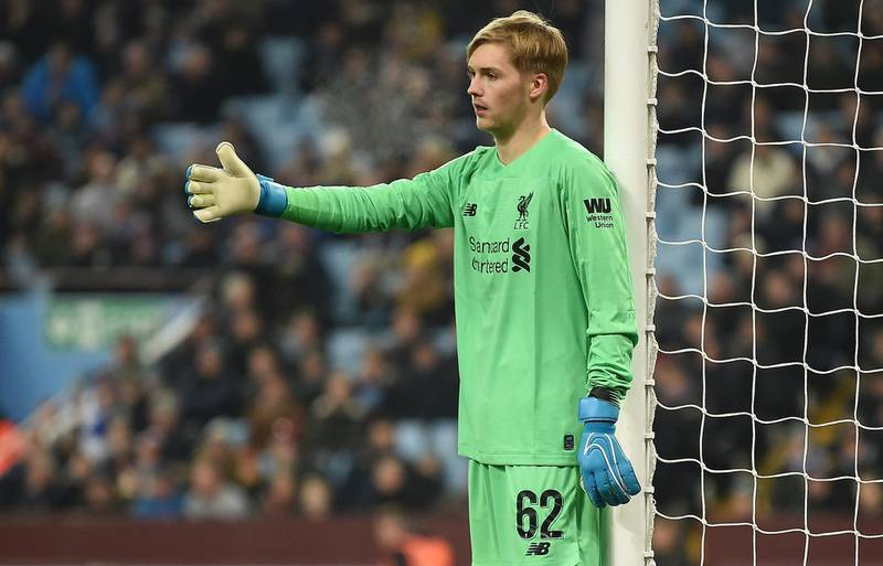 Liverpool's Irish goalkeeper Caoimhin Kelleher gestures to his teammates during the English League Cup quarter-final football match between Aston Villa and Liverpool at Villa Park in Birmingham, central England, on December 17, 2019. (Photo by Paul ELLIS / AFP) / RESTRICTED TO EDITORIAL USE. No use with unauthorized audio, video, data, fixture lists, club/league logos or 'live' services. Online in-match use limited to 120 images. An additional 40 images may be used in extra time. No video emulation. Social media in-match use limited to 120 images. An additional 40 images may be used in extra time. No use in betting publications, games or single club/league/player publications. /