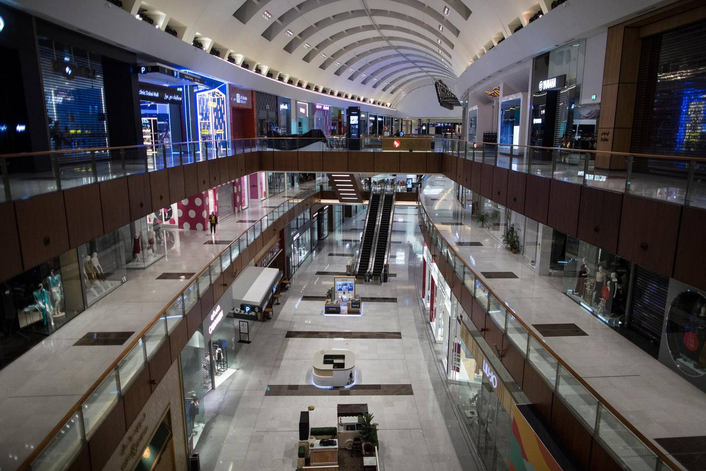 epa08319760 A view of the empty Dubai Mall after shutdown, in Dubai, United Arab Emirates, 24 March 2020. The UAE Ministry of Health and Community Protection and the National Emergency and Crisis Authority decided to close all commercial centers, shopping centers and open markets that include the sale of fish, vegetables and meat, and exclude in the fish, vegetable and meat markets dealing with supply and wholesale companies. The protective measures were taken due to the coronavirus that causes the COVID-19 disease.  EPA/MAHMOUD KHALED