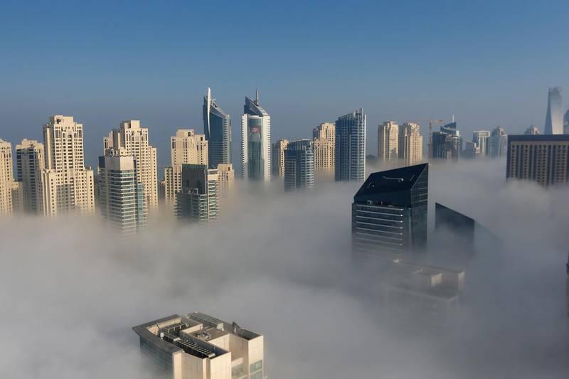 DUBAI, UAE. January 8, 2015 - Morning fog sweeps over Dubai Marina, January 8, 2015. (Photos by: Sarah Dea/The National, Story by: Standalone, News) *** Local Caption ***  SDEA080115-fog01.JPG