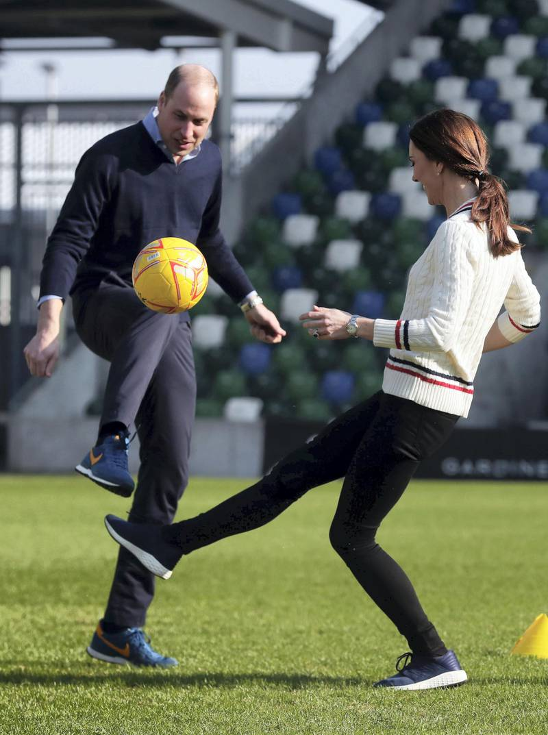 BELFAST, NORTHERN IRELAND - FEBRUARY 27:  Prince William Duke of Cambridge and Catherine, Duchess of Cambridge, play football as they visit the National Stadium in Belfast, home of the Irish Football Association on February 27, 2019 in Belfast, Northern Ireland. Prince William last visited Belfast in October 2017 without his wife, Catherine, Duchess of Cambridge, who was then pregnant with the couple's third child. This time the couple concentrate on the young people of Northern Ireland. Their engagements include a visit to Windsor Park Stadium, home of the Irish Football Association, activities at the Roscor Youth Village in Fermanagh, a party  at the Belfast Empire Hall, Cinemagic -a charity that uses film, television and digital technologies to inspire young people and finally dropping in on a SureStart early years programme. (Photo by Kelvin Boyes -  Pool/Getty Images)