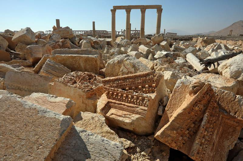 A picture shows the ruins of Syria's Roman-era ancient city of Palmyra on February 7, 2021, in the country's central province of Homs. - Syria has six sites listed on the UNESCO elite list of world heritage and all of them sustained some level of damage in the 10-year war. Besides Palmyra and Aleppo, the ancient cities of Damascus and Bosra also sustained some damage. (Photo by LOUAI BESHARA / AFP)