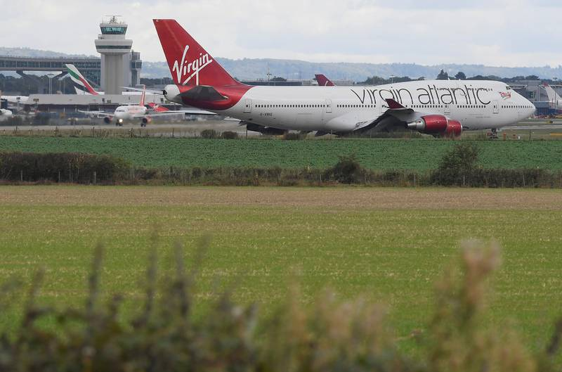 FILE PHOTO: A Virgin Atlantic passenger aircraft prepares for take off from Gatwick Airport in southern England, Britain, October 9, 2016. REUTERS/Toby Melville/File Photo