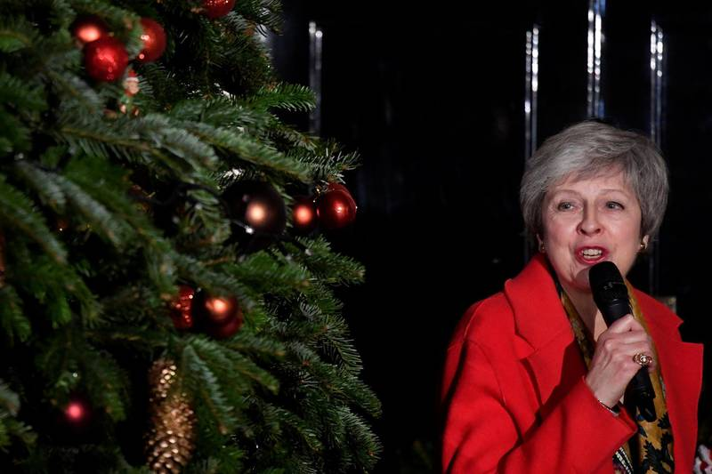 Britain's Prime Minister, Theresa May, uses a microphone  during the ceremony of switching on the lights of the Christmas tree in Downing Street, in central London, Britain December 6, 2018.  REUTERS/ Toby Melville