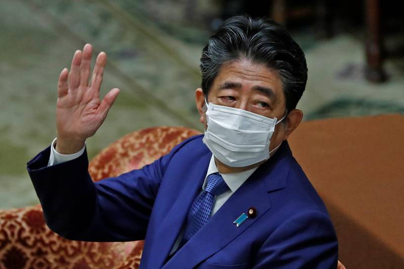 Former Japanese Prime Minister Shinzo Abe gestures while attending the lower house parliamentary session to face questioning over a possible violation of election funding laws, in Tokyo, Japan December 25, 2020.  REUTERS/Issei Kato