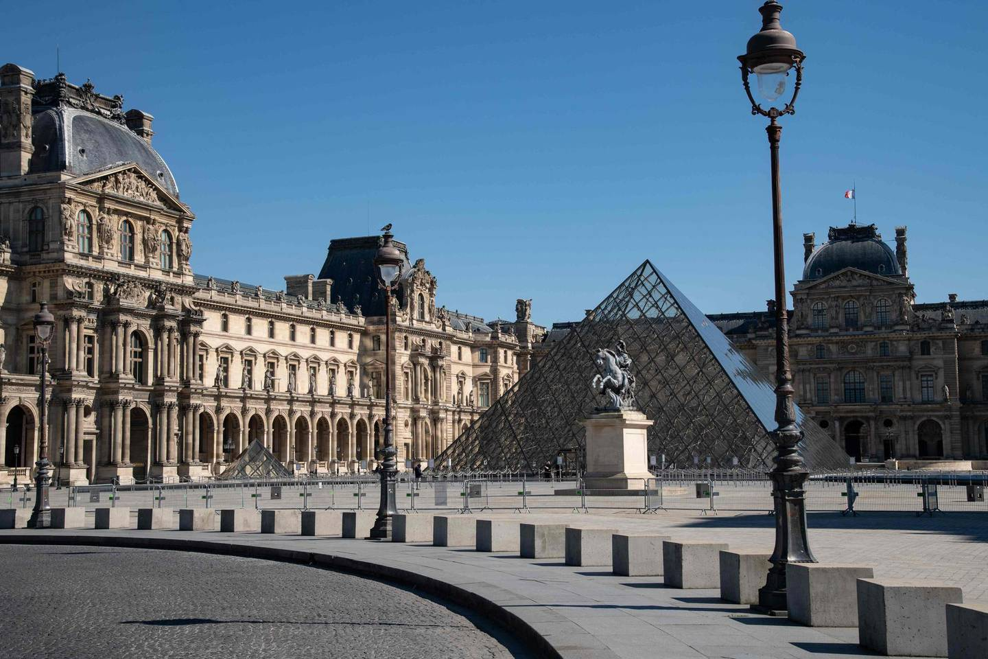 A picture taken on March 23, 2020, in Paris, shows the Louvre pyramid designed by Ieoh Ming Pei, on the seven day of a strict lockdown in France aimed at curbing the spread of COVID-19 caused by the novel coronavirus. RESTRICTED TO EDITORIAL USE - MANDATORY MENTION OF THE ARTIST UPON PUBLICATION - TO ILLUSTRATE THE EVENT AS SPECIFIED IN THE CAPTION  / AFP / BERTRAND GUAY / RESTRICTED TO EDITORIAL USE - MANDATORY MENTION OF THE ARTIST UPON PUBLICATION - TO ILLUSTRATE THE EVENT AS SPECIFIED IN THE CAPTION