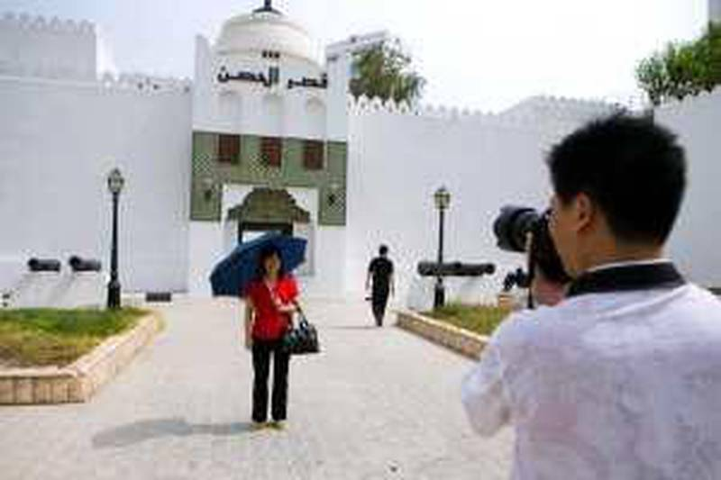 Abu Dhabi - August 2, 2008: Chinese tourists visit Al Hosin Fort in downtown Abu Dhabi. Lauren Lancaster / The National  *** Local Caption ***  LL_02.08.08-ad fort007.jpgLL_02.08.08-ad fort007.jpgBZ17JU TOURISM.jpg