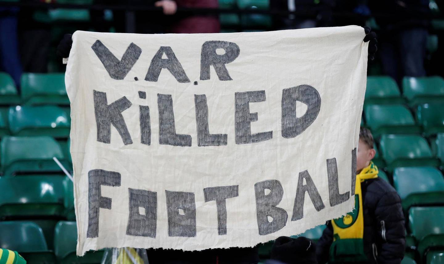 """Soccer Football - Premier League - Norwich City v Crystal Palace - Carrow Road, Norwich, Britain - January 1, 2020  Norwich City fans hold up a banner regarding VAR after the match     Action Images via Reuters/Peter Cziborra  EDITORIAL USE ONLY. No use with unauthorized audio, video, data, fixture lists, club/league logos or """"live"""" services. Online in-match use limited to 75 images, no video emulation. No use in betting, games or single club/league/player publications.  Please contact your account representative for further details."""