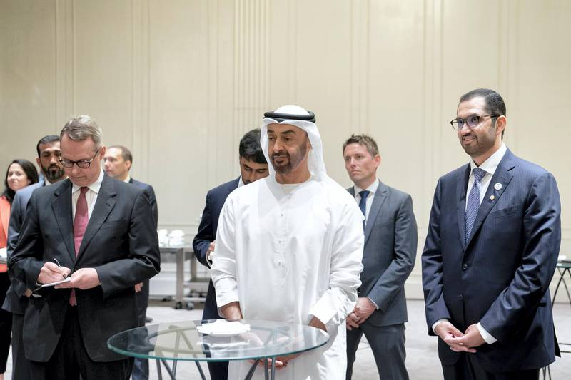 BERLIN, GERMANY - June 12, 2019: HH Sheikh Mohamed bin Zayed Al Nahyan, Crown Prince of Abu Dhabi and Deputy Supreme Commander of the UAE Armed Forces (C), meets with representatives of German companies from various sectors, in Berlin. Seen with HE Dr Sultan Ahmed Al Jaber, UAE Minister of State, Chairman of Masdar and CEO of ADNOC Group (R).  (Eissa Al Hammadi / For the Ministry of Presidential Affairs )