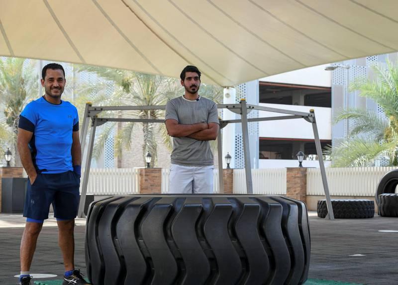 Nasser Al Ketbi-AD Nasser Al Ketbi, 23, with his guardian and mentor Hand Esaad, 50 at the Abu Dhabi Country Club on May 24, 2021. Khushnum Bhandari / The National  Reporter: Haneen Dajani News