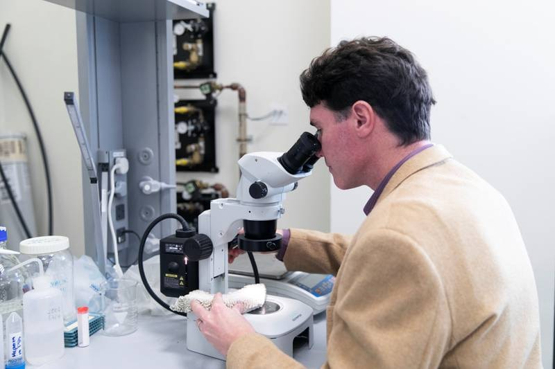"""ABU DHABI, UNITED ARAB EMIRATES - JANUARY 31, 2019.John A. Burt, Associate Professor of Biology, Center for Genomics and Systems Biology,New York University Abu Dhabi, researched how corals are being damaged by high temperatures. The research's focus was about a """"bleaching"""" event in 2017 when much of the coral in the southern Arabian Gulf was killed by prolonged exposure to warm water.(Photo by Reem Mohammed/The National)Reporter: Daniel BardsleySection:  NA"""