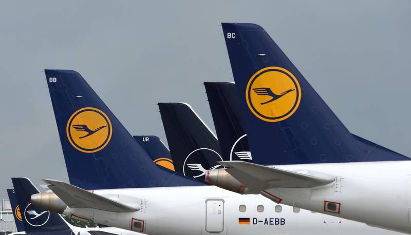 """The tails of aircraft of the German airline Lufthansa are seen at the """"Franz-Josef-Strauss"""" airport in Munich, southern Germany, on June 11, 2020.  German airline Lufthansa said on June 11, 2020 that it would have to slash 22,000 full-time jobs as the recovery in demand for travel following the coronavirus pandemic will be muted. / AFP / Christof STACHE"""