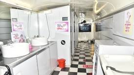 Decommissioned buses turned into public toilets for India's female commuters