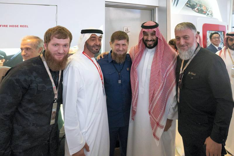 YAS ISLAND, ABU DHABI, UNITED ARAB EMIRATES - December 01, 2019: HH Sheikh Mohamed bin Zayed Al Nahyan, Crown Prince of Abu Dhabi and Deputy Supreme Commander of the UAE Armed Forces (4th R), stands for a photograph with HE Ramzan Kadyrov, President of the Chechnya (3rd R) and HRH Prince Mohamed bin Salman bin Abdulaziz, Crown Prince, Deputy Prime Minister and Minister of Defence of Saudi Arabia (2nd R), during the final race of the Formula 1 2019 Etihad Airways Abu Dhabi Grand Prix, at Shams Tower.  ( Hamad Al Kaabi  / Ministry of Presidential Affairs ) ---