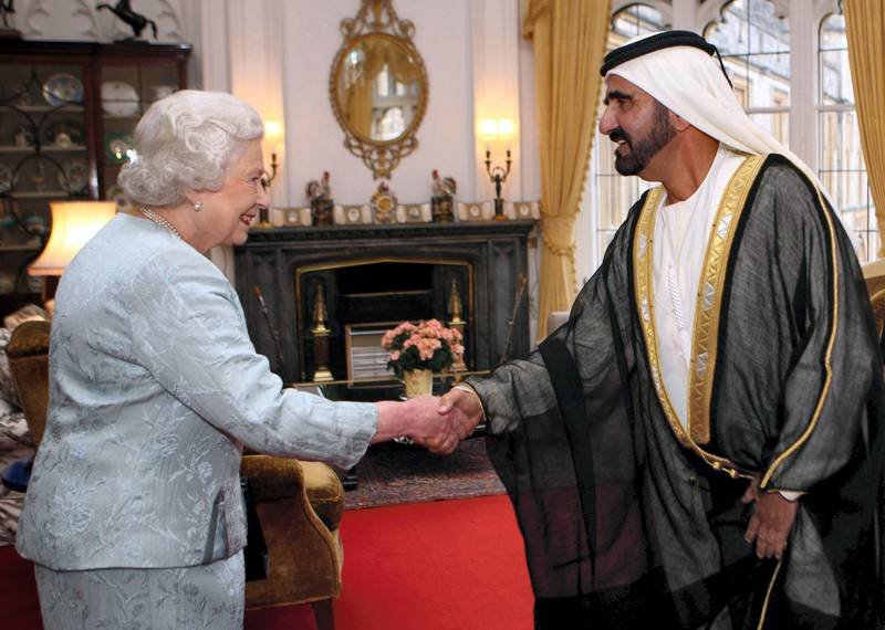 A handout picture from the media office of Vice President, Prime Minister and Defence Minister of the UAE and Ruler of Duabi, Sheikh Mohammad bin Rashid al-Maktoum (R), shows the latter shaking hands with Britain's Queen Elizabeth II during a meeting in Windsor Castle in London on November 23, 2009. AFP PHOTO/HO/ SHEIKH MOHAMMAD AL-MAKTOUM MEDIA OFFICE  == RESTRICTED TO EDITORIAL USE == (Photo by SHEIKH MOHAMMAD AL-MAKTOUM OFFIC / AFP)
