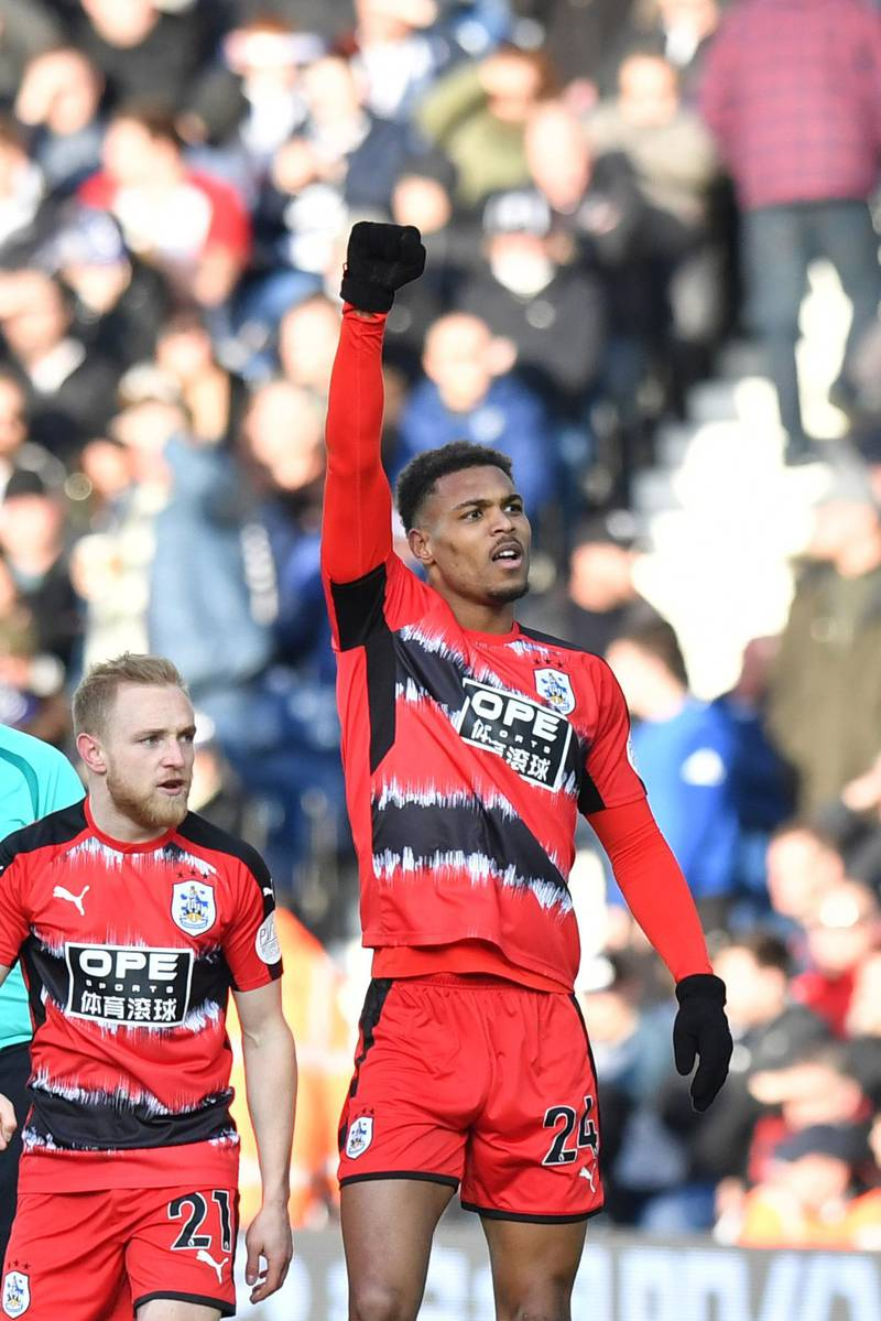 Huddersfield Town's Steve Mounie celebrates scoring his side's second goal of the game during the English Premier League soccer match, West Bromwich Albion against Huddersfield Town at The Hawthorns, West Bromwich, England, Saturday Feb. 24, 2018. (Anthony Devlin/PA via AP)