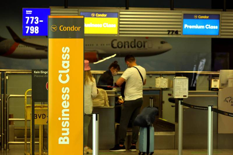 Travelers at the Condor Flugdienst GmbH business class check-in area at Frankfurt Airport in Frankfurt, Germany, on Tuesday, June 8, 2021. Ryanair will tomorrow appeal the European Commission's decision in April 2020 to approve Covid-19-related aid in the form of a 550 million-euro German State-guaranteed loan to charter airline Condor. Photographer: Alex Kraus/Bloomberg