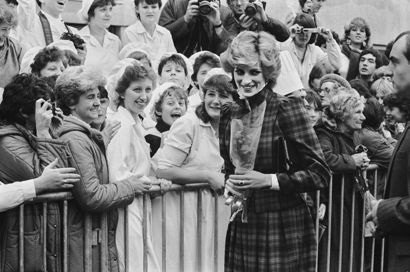 Diana, Princess of Wales (1961-1997) wearing a tartan dress by Caroline Charles as she meets well wishers during a visit to Bridgend, Wales, 29th January 1985. (Photo by Stroud/Daily Express/Hulton Archive/Getty Images)