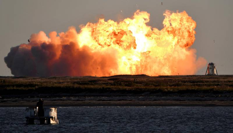 SpaceX's first super heavy-lift Starship SN8 rocket explodes during a return-landing attempt after it launched from their facility on a test flight in Boca Chica, Texas U.S. December 9, 2020. REUTERS/Gene Blevins