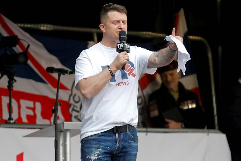 Far-right activist Stephen Yaxley-Lennon, who goes by the name Tommy Robinson, speaks outside the Houses of Parliament at a pro-Brexit demonstration in London, Britain March 29, 2019. REUTERS/Alkis Konstantinidis