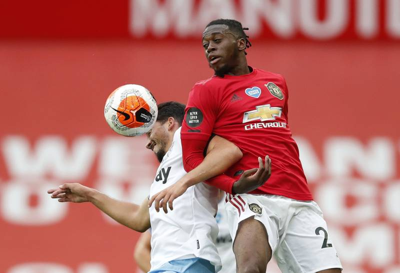 Soccer Football - Premier League - Manchester United v West Ham United - Old Trafford, Manchester, Britain - July 22, 2020 Manchester United's Aaron Wan-Bissaka in action, as play resumes behind closed doors following the outbreak of the coronavirus disease (COVID-19) Pool via REUTERS/Clive Brunskill EDITORIAL USE ONLY. No use with unauthorized audio, video, data, fixture lists, club/league logos or 'live' services. Online in-match use limited to 75 images, no video emulation. No use in betting, games or single club/league/player publications.  Please contact your account representative for further details.