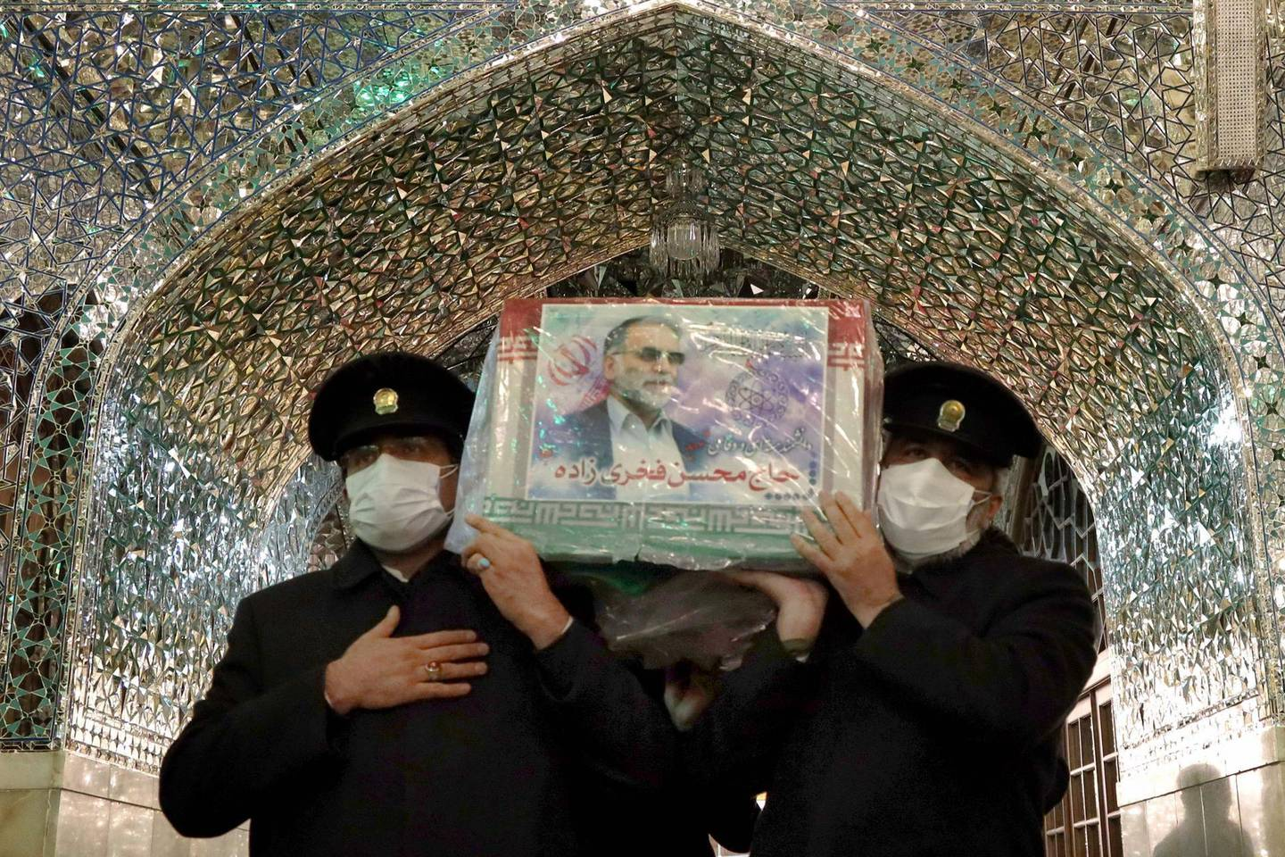 """A handout picture provided by Iran's Defence Ministry on November 29, 2020 shows Servants of the Imam Reza Shrine carrying the coffin of Iran's assassinated top nuclear scientist Mohsen Fakhrizadeh during his funeral procession in the northeastern city of Mashhad. The body of Iran's assassinated top nuclear scientist has been taken to the first of several revered Shiite Muslim shrines ahead of his burial set for November 30, state media reported. The killing of Fakhrizadeh -- whom Israel has dubbed the """"father"""" of Iran's nuclear programme -- has once more heightened tensions between the Islamic republic and its foes. - ==  RESTRICTED TO EDITORIAL USE - MANDATORY CREDIT """"AFP PHOTO / HO /IRANIAN DEFENCE MINISTRY"""" - NO MARKETING NO ADVERTISING CAMPAIGNS - DISTRIBUTED AS A SERVICE TO CLIENTS ==  / AFP / IRANIAN DEFENCE MINISTRY / - / ==  RESTRICTED TO EDITORIAL USE - MANDATORY CREDIT """"AFP PHOTO / HO /IRANIAN DEFENCE MINISTRY"""" - NO MARKETING NO ADVERTISING CAMPAIGNS - DISTRIBUTED AS A SERVICE TO CLIENTS =="""