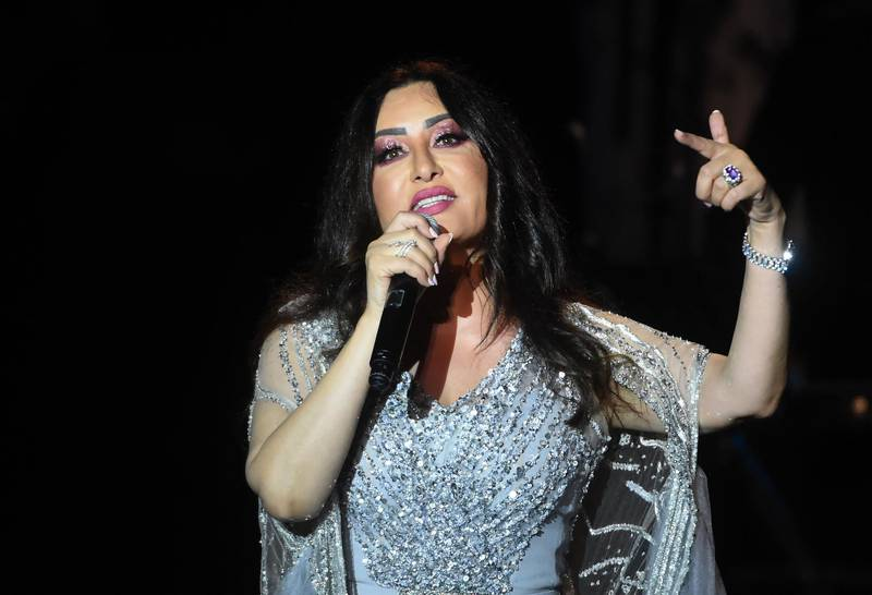 Tunisian singer Latifa performs at the Roman theater during the International Carthage Festival in the ancient city of the same name, just outside the Tunisian capital Tunis, late on July 18, 2019. (Photo by FETHI BELAID / AFP)